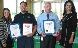 Code Inspection Officer Jorge Self and Fire Services Coordinator Greg Schreiner hold up the Fire Authority's Agency Award and letters of recognition for their service with (at left) Aida Castaneda from Assemblywoman Lorena Gonzalez' office and Lori Brown from Senator Joel Anderson's office (at right).